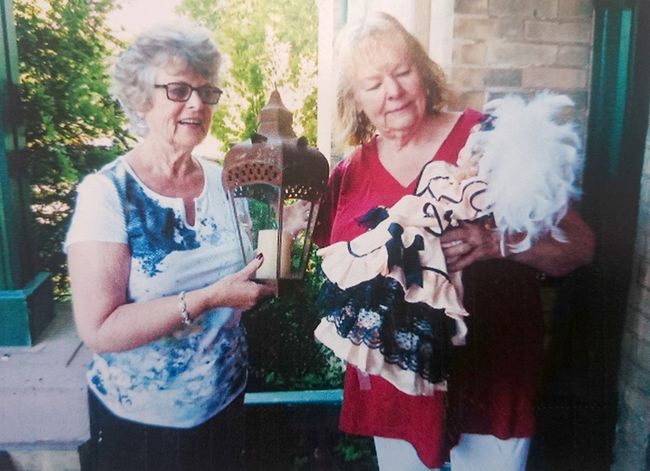 Canadian Federation of University Women (CFUW) Kincardine chapter organizer Corabelle Danahy and president Jane Rigby look over items for the upcoming Treasure Sale Fundraiser on July 11, 2016, on Princes Street across from Victoria Park.