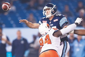 Argonauts QB Ricky Ray unloads a pass under pressure from the Lions during a game at the Rogers Centre. Ray is expecting more of the same tonight from a B.C. defence that has yielded just 21 points in two games. (The Canadian Press)