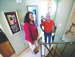 Minister of Seniors and Housing Lori Sigurdson and homeowner David Osborne share a laugh as they stand at the top of the stairs, where Osborne and his wife hope to have a chair installed with the new SHARP program. (Megan Voss News Staff)