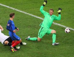 France's Antoine Griezmann (centre) scores his side's second goal during the Euro 2016 semifinal match against Germany at the Velodrome stadium in Marseille, France, on Thursday, July 7, 2016. (Thibault Camus/AP Photo)