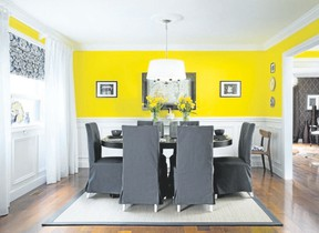 Lower panels painted a crisp white and topped off with a summery yellow make for a thoroughly liveable dining space.