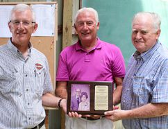 Alphonse and Phoebe Marchand were recognized by the Canadian National Shuffleboard Association on Thursday, July 7, 2016, near Chatham, Ont. for their contribution to the sport, including hosting the first Canadian Open shuffleboard tournament in 1980. Pictured, from left, with a plaque honouring the Tilbury, Ont. area couple, are; grandson John Carson, Henry Strong, immediate past president of the CNSA, and Glen Peltier, friend and long-time local shuffleboard player. (ELLWOOD SHREVE/THE DAILY NEWS)