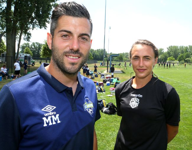 London FC head coach Mike Marcoccia is seen in this Free Press file photo with a player on his women's team, Jade Kovacevic. (MIKE HENSEN, The London Free Press)
