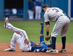 Toronto Blue Jays' Edwin Encarnacion tumbles into second with a double under the tag of Detroit Tigers' Ian Kinsler on July 9. THE CANADIAN PRESS/Fred Thornhill