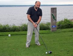 Pembroke's Deputy Mayor Ron Gervais, who also heads the board of directors for the Pembroke Handi-Bus, tees off at the start of the 17th annual Pembroke Lumber Kings Alumni Golf Tournament, held Friday at the Pembroke Golf Club. The event was mainly a social event, but it also raised around $1,000 for the Handi-Bus and a new bursary for Lumber Kings players.