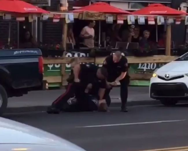 Screen grab of video posted to social media showing part of a confrontation between a man and three police officers on 17 Ave. S.W. in the downtown core.