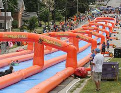 Sliders head down Nelson Street in Meaford on the Urban Slide in this photo from 2016. The water slide, which had been scheduled to come to Pembroke at the end of August, has been cancelled due poor weather and other factors. (James Masters The Sun Times)