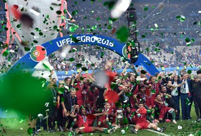 Portugal players celebrate after winning the Euro 2016 final soccer match between Portugal and France at the Stade de France in Saint-Denis, north of Paris, Sunday, July 10, 2016. Portugal won 1-0. (AP Photo/Martin Meissner)