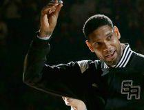 In this Oct. 28, 2014, file photo, San Antonio Spurs' Tim Duncan, left, holds up his 2014 NBA championship ring during a ceremony prior to an NBA basketball game between the Spurs and the Dallas Mavericks, in San Antonio. Duncan announced his retirement on Monday, July 11, 2016, after 19 seasons, five championships, two MVP awards and 15 All-Star appearances. It marks the end of an era for the Spurs and the NBA. (AP Photo/Eric Gay, File)