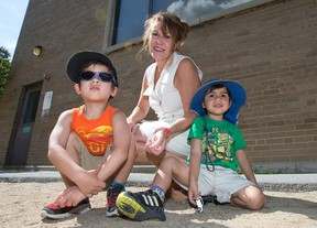 Carmen Perron, seen here with Noah Marois, 3, (L) and his brother Cedric, 2, is the director of the daycare that was under threat to close after its federal funding was revoked. It has now received a lifeline from the Liberal government amounting to a rent freeze until 2019.   Wayne Cuddington/ Postmedia