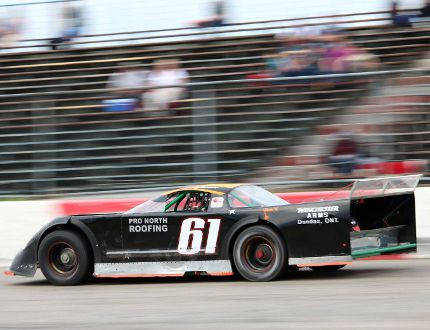 Dustin Jackson pilots a super late model car in action in 2016.