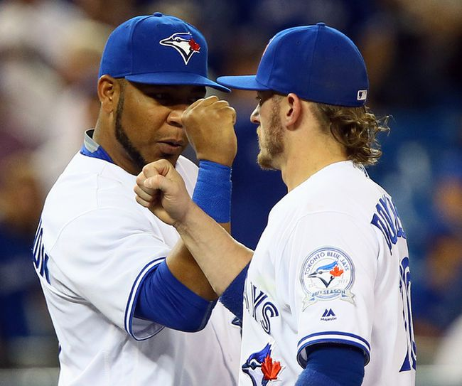 Edwin Encarnacion and Josh Donaldson of the Toronto Blue Jays celebrate a win over the Kansas City Royals at the Rogers Centre in Toronto on July 5, 2016. (Dave Abel/Toronto Sun/Postmedia Network)