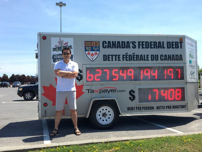 <p>Aaron Wudrick, federal director of Canadian Taxpayers Federation (CTF), stopped in Kingston, Ont. on Tuesday, July 12, 2016, as part of a national tour to raise awareness about federal debt. Wudrick, seen here, set up in the parking lot of the RioCan Centre, with the CTFs Federal Debt Clock. Jacob Rosen for the Whig-Standard/Postmedia Network