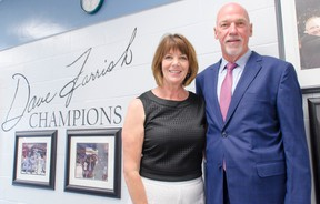 Retired NHL defenseman, current Colorado Avalanche assistant coach and Lucknow native Dave Farrish, right, poses with his wife Roxanne Farrish before a wall of photographs in the Lucknow arena commemorating his 2007 Stanley Cup championship with the Anaheim Ducks. The wall was unveiled during the Dave Farrish Champions Chamber room dedication Saturday, July 9, 2016, in front of almost 100 of his friends and family. The event was part of an entire Day Farrish Day that was planned by the community to celebrate Farrish's hockey accomplishments and commitment to his home community. (Darryl Coote/Reporter)