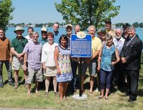 Members of the St. Clair Township Heritage Committee pose with members of St. Clair Township council, Lambton County Warden Bev MacDougall and historian John Carter at the newly unveiled plaque at Sombra's Riverside Park, which commemorates the events of June 28, 1838, when a group of insurgents raided Sombra. CARL HNATYSHYN/SARNIA THIS WEEK