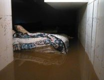 A bed floats almost to the ceiling of this basement in Arborfield, which has experienced flooding due to the heavy rainfall