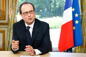 French President Francois Hollande gestures after a televised interview following the Bastille Day Parade in Paris, Thursday, July 14, 2016, at the Elysee Palace. (AP Photo/Francois Mori, Pool)