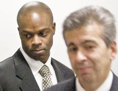 RCMP Const. Kwesi Millington and his lawyer Ravi Hira at the Braidwood Inquiry in 2009. FILE PHOTO, 24 HOURS
