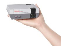 """This undated product image provide by Nintendo of America shows the Nintendo Entertainment System Classic edition that comes complete with 30 built-in games, including all three """"Super Mario Bros.,"""" ''Donkey Kong,"""" ''The Legend of Zelda,"""" and """"Punch-Out."""" Nintendo says it's bringing back the wildly popular system that launched in the 1980s so those who grew up with it can pass gaming memories onto the next generation. The system goes on sale Nov. 11, 2016. (Nintendo of America via AP)"""