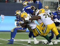 Winnipeg Blue Bombers QB Drew Willy is sacked by Edmonton Eskimos DL Odell Willis during CFL action in Winnipeg on Thu., July 14, 2016. Kevin King/Winnipeg Sun/Postmedia Network