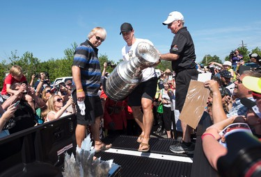 Pittsburgh Penguins' Sidney Crosby, centre, carries the Stanley Cup prior to a parade through his hometown of Cole Harbour, N.S., on Saturday, July 16, 2016. THE CANADIAN PRESS/Darren Calabrese