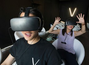Gary Tam, Co-founder of Vivid VR gives Sun reporter Jenny Yuen  a tour of the virtual reality experience at the Dundas Street West theatre pop-up just opened, on Saturday July 16, 2016. Stan Behal/Toronto Sun/Postmedia Network