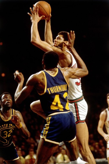 Kareem Abdul-Jabbar #33 of the Milwaukee Bucks goes up for a shot against Nate Thurmond #42 of the Golden State Warriors during the 1970 season at the MECCA Arena in Milwaukee, Wis. (Photo by Vernon Biever/NBAE via Getty Images)