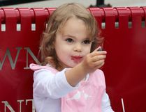 Two-year-old Ivy Jones, of London, enjoyed more than her share of sweet cherries during Cherry Fest in Blenheim, Ont. on Saturday July 16, 2016. Vicki Gough/Chatham Daily News/Postmedia Network