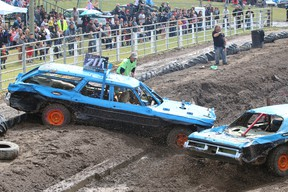 A car is pushed outside the dirt boundaries during a three on three match of the Team Showdown Demolition. No drivers were injured. See this week's newspaper for story.