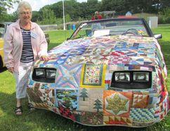 Marion Ford, of Brigden, stands with her 1983 Mustang convertable, and the quilted cover she recently made for it, during Hobbyfest in Centennial Park on Sunday July 17, 2016 in Sarnia, Ont. Paul Morden/Sarnia Observer/Postmedia Network