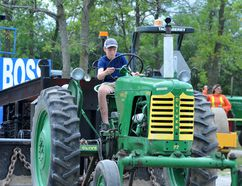Jacob Edmunds takes part in the Vintage Tractor Pull at Farmersville on Saturday. (RONALD ZAJAC/The Recorder and Times)