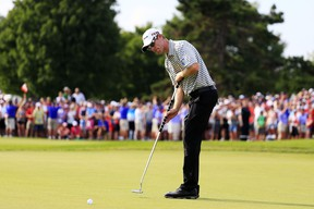 David Hearn of Canada putts on the 18th green during the final round of the RBC Canadian Open at Glen Abbey Golf Club on July 26, 2015 in Oakville, Canada. (Cliff Hawkins/Getty Images/AFP)