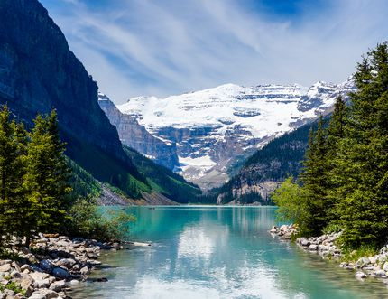 """<b>Lake Louise, Alberta:</b> True, you won't be alone on the tidy shore of Lake Louise as you jockey for position at sunrise. However, the early start is always rewarded. An image of this lake is, for many millions of visitors, the ultimate """"Canadian"""" keepsake. (Getty Images)"""