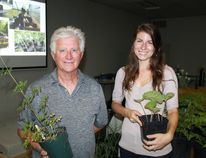 Bluewater Trails' Tony Barrand and Return the Landscape's Felicia Syer hold up a pair of rescued plants from the Howard Watson Nature Trail. The pair discussed the past, present and future of the trail during Green Drinks Sarnia on July 13. CARL HNATYSHYN/SARNIA THIS WEEK