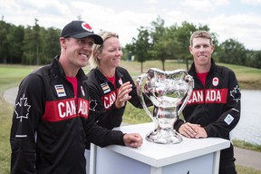 Members of the Canadian Olympic Golf team (from left to right) Graham DeLaet, Alena Sharp and David Hearn pose with the 1904 Olympic Golf Trophy, following a ceremony at Glen Abbey Golf Club in Oakville, Ont., on Tuesday, July 19, 2016. The team also includes Brooke Henderson who was unable to attend the announcement. (Chris Young/The Canadian Press)