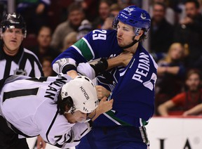 Los Angeles Kings forward Jordan Nolan and Vancouver Canucks defenseman Andrey Pedan fight during the first period at Rogers Arena. (Anne-Marie Sorvin-USA TODAY Sports)