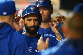 Jose Bautista of the Toronto Blue Jays is congratulated by teammates after scoring a run in the fourth inning against the Philadelphia Phillies at Citizens Bank Park on June 16, 2016 in Philadelphia, Pennsylvania. (Drew Hallowell/Getty Images)