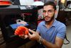 Moath Abuaysha holds part of an artificial hand he created on his 3D printer. The 23-year-old western student is now printing a prosthetic arm for a Syrian child war amputee. MORRIS LAMONT  / THE LONDON FREE PRESS / POSTMEDIA NETWORK