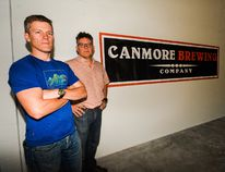 Brian Dunn, left, and Marc Gagne, co-owners of the Canmore Brewing Company, are worried that a jump in taxes on beer products sold in Alberta will affect their bottom line. (Daniel Katz/ Crag & Canyon/ Postmedia Network)