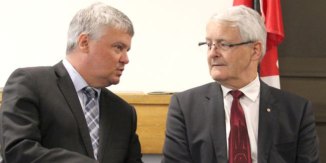 Sault Ste. Marie MP Terry Sheehan and Transport Minister Marc Garneau speak before a funding announcement at Sault Ste. Marie Airport on Wednesday.