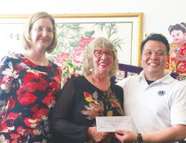 The Edmonton Chinese Lions Club recently buoyed up the Strathcona County Library's easy English collection with a $3,000 donation. Photo supplied