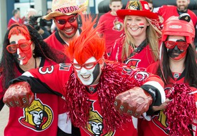 Steve Barnett (centre) is all painted up along with his buddies outside Canadian Tire Centre prior to a game between the Montreal Canadiens and the Ottawa Senators. Wayne Cuddington / Postmedia