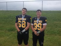 Zack McNeil (left) and a teammate pose with their silver medals after their Zone 5 football team finished in second place at last weekend's Alberta Summer Games in Leduc. Submitted