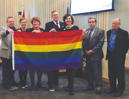 Issues of LGBTQ rights have come to the forefront in the county after the Rebel Media attacked a local gender-variant MLA, and the Park's AltView Foundation alleged a mass exodus of local LGBTQ members. Left to right: Coun. Paul Smith, Coun. Bonnie Riddell, Mayor Roxanne Carr, AltView executive director Bryan Mortensen, Coun. Fiona Beland-Quest, Coun. Linton Delainey, and Coun. Vic Bidzinski. File Photo