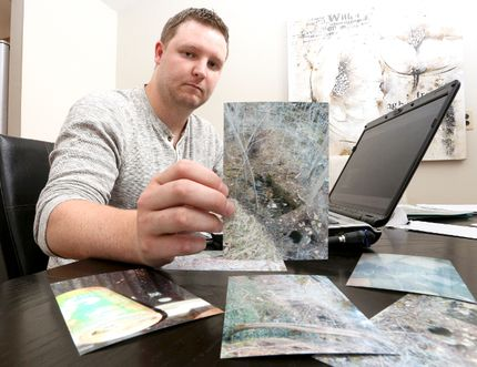 Owen Sound resident Nick Oldrieve holds up a photo he took of a location were he believes the body of Lisa Maas maybe located. Oldrieve has been trying to find Lisa Maas, who was last seen on July, 17, 1988. He has set up a website in an effort to attract tips. (James Masters/The Owen Sound Sun Times/Postmedia Network)