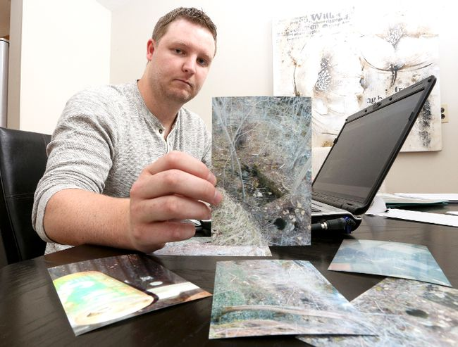 Owen Sound resident Nick Oldrieve in this July 2016 file photo holds up a photo he took of a location were he believes the body of Lisa Maas may be located. Oldrieve has been trying to find Lisa Maas, who was last seen on July, 17, 1988. (James Masters/The Owen Sound Sun Times/Postmedia Network)