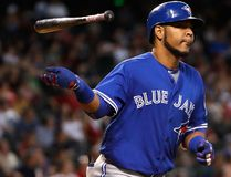 Edwin Encarnacion of the Toronto Blue Jays flips his bat after hitting a home run against the Arizona Diamondbacks during the eighth inning of an interleague game at Chase Field in Phoenix on Aug. 20, 2016. (Christian Petersen/Getty Images)