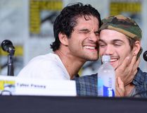 "Actor Tyler Posey (L) after pouring a bottle of water on himself next to actor Dylan Sprayberry during the ""Teen Wolf"" panel during Comic-Con International 2016 at San Diego Convention Center on July 21, 2016 in San Diego, California. (Photo by Matt Winkelmeyer/Getty Images)"
