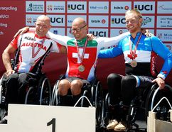 Para-cyclist Alex Hyndman, right, of Rondeau Bay Estates celebrates his bronze medal at the World Cup time trial Friday, July 15, 2016, in Bilbao, Spain. (Contributed Photo)