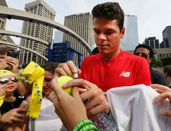 Canadian tennis star Milos Raonic signs autographs for fans in Toronto on July 21, 2016. (Stan Behal/Toronto Sun/Postmedia Network)